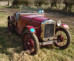An Austin Seven. Out standing in its field.